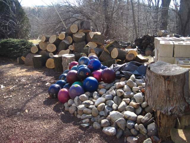 Bowling balls, stone, wood and blocks all waiting for inspiration.