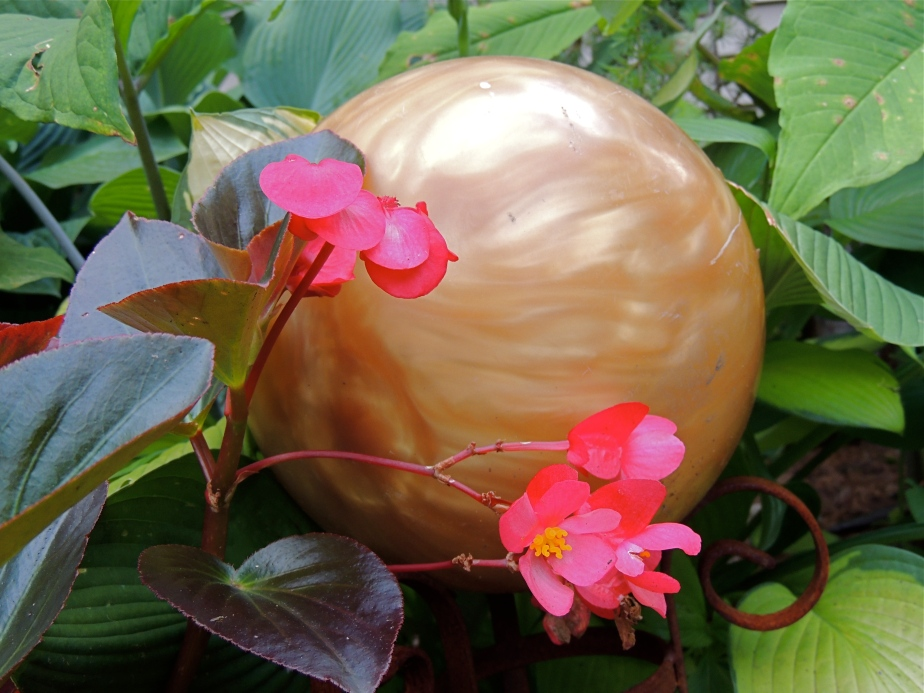 Bowling ball sphere and begonia flowers