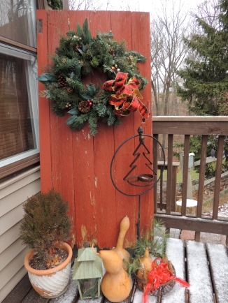 An old barn door becomes the focus of the side entrance