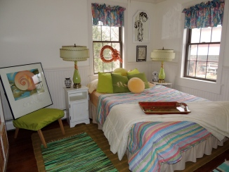 Upstairs two guest rooms await visiting family