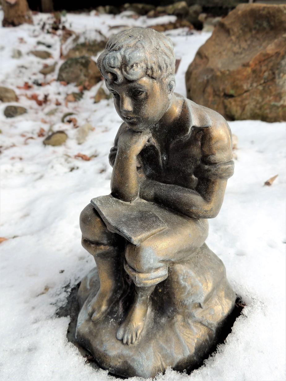 Bronze sculpture sitting in the snow
