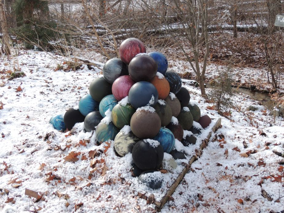 Aging Bowling ball pyramid in the lower gardens
